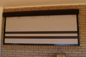 Roller shutter with accent slats
